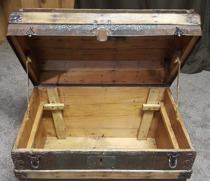 inside DIY Toy Box Treasure Chest from Antique Steamer Trunk