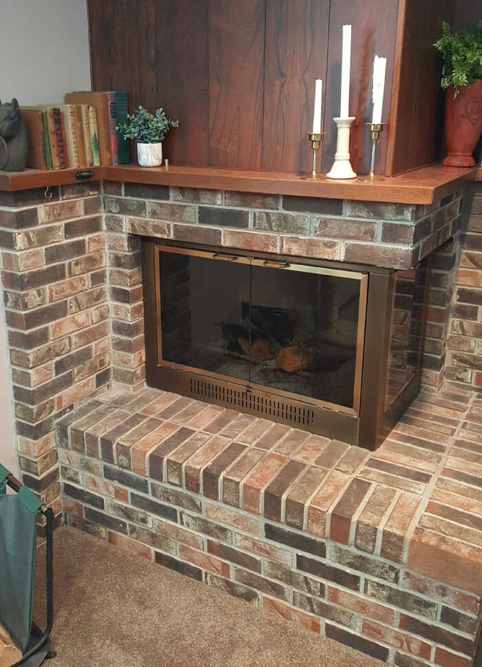 old pink brick fireplace - grey wash brick fireplace