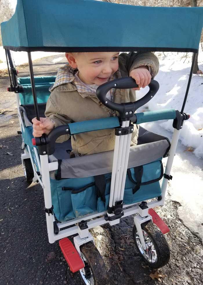 toddler riding collapsible wagon | push wagon stroller