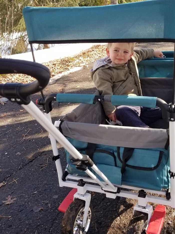toddler riding push wagon stroller
