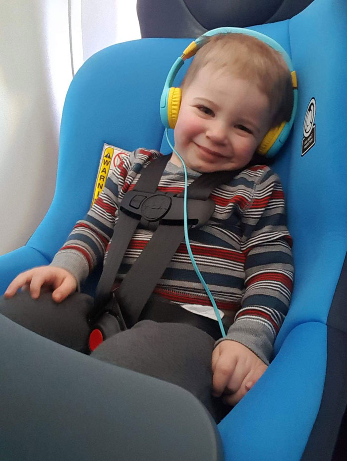 flying with toddler - car seat and headphones